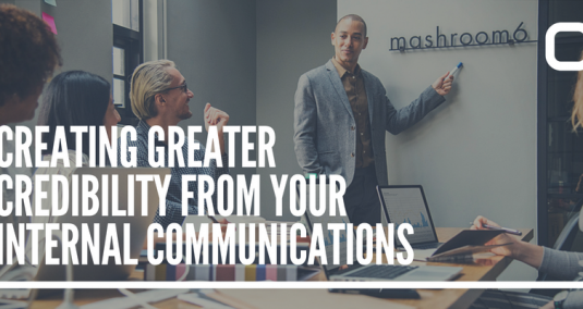 """A team in a meeting room, and the words """"Creating greater credibility from your internal communications"""""""