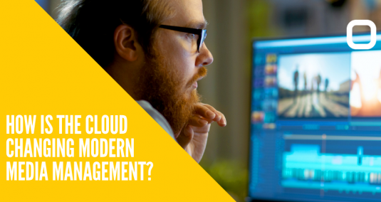 """A man at a screen and the words """"How is the cloud changing modern media management?"""""""