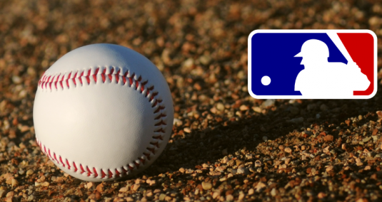 A baseball on the ground and the Major League Baseball logo