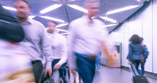 Slow-motion shot of people walking through an airport