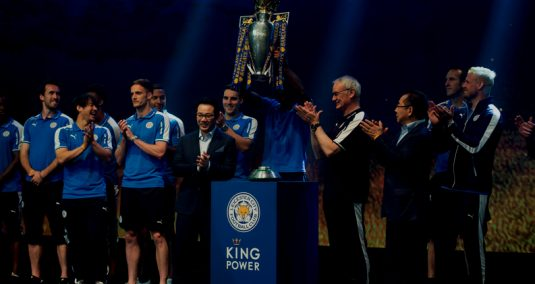 The Leicester team stand on stage in Lampang