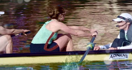 Two women rowing, with their coxswain