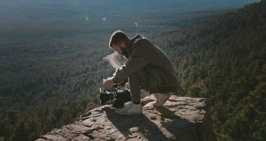 Cameraman on top of hill